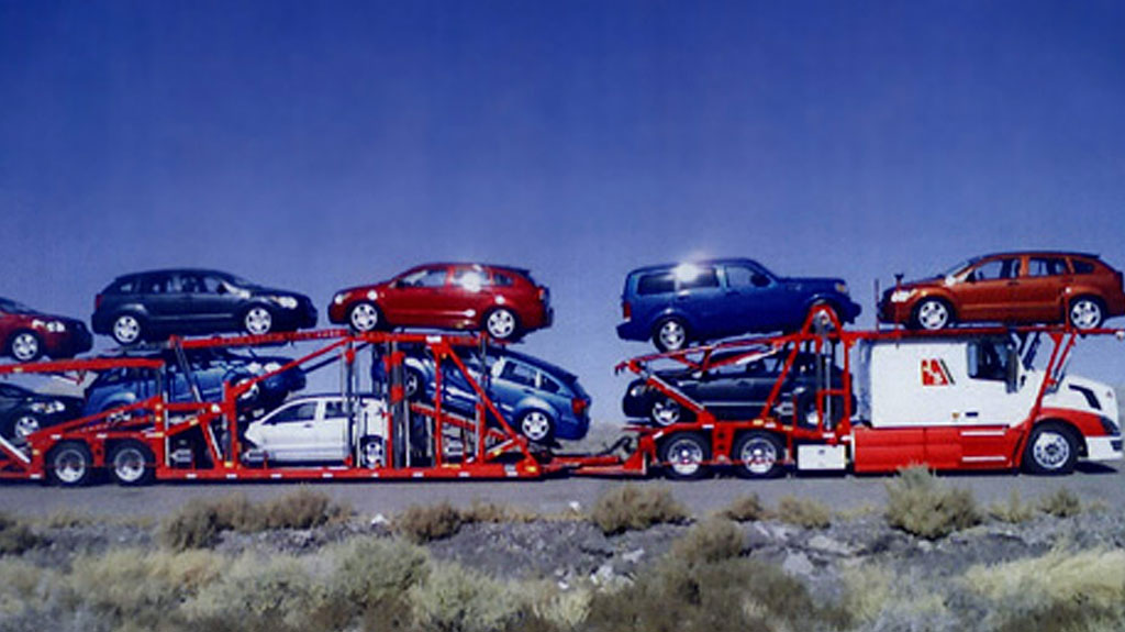 J&S auto hauler loaded for car transport interstate